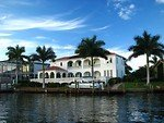 9841-a-fancy-house-along-the-water-with-palm-trees-th
